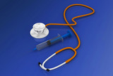 stethoscope and syringe.