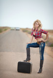 Attractive hiking woman hitchhiking on road sexy cowboy girl