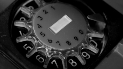 Dialing phone number on rotary telephone