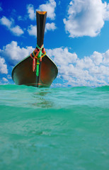 Longtail boat on the sea tropical beach
