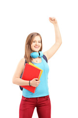 Happy female student gesturing happiness with raised hands