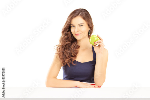 Beautiful female holding a green apple