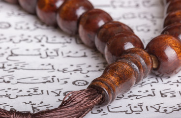 Koran and prayer beads close-up