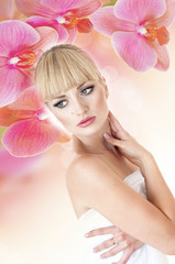 Sensual blonde woman covers a floral background.