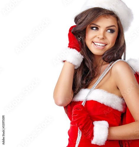 Christmas woman wearing a Santa hat smiling - isolated over a wh
