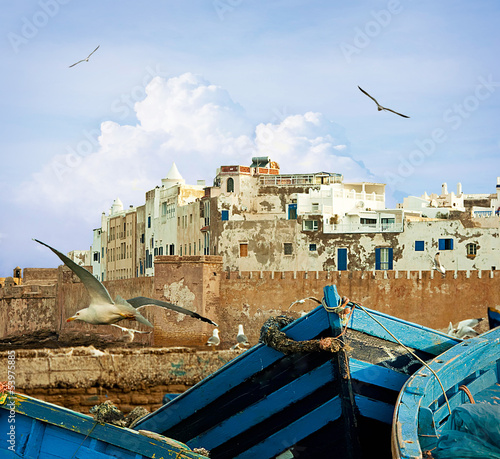 Blue fishing boats on an ocean coast in Essaouira, Morocco
