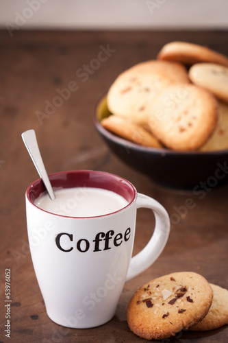 Cup of coffee with two homemade cookies