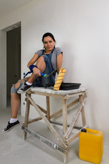 Young woman taking a break from renovating