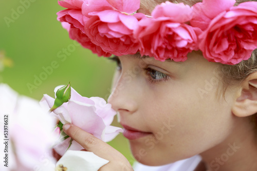 Rose garden - beautiful girl playing in the rose garden