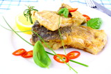 Fried fish fillets with lemon, chili peppers slice