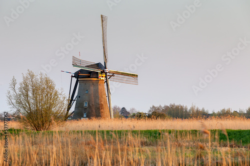 Windmill near Kinderdijk at sunset, South Holland, Netherlands