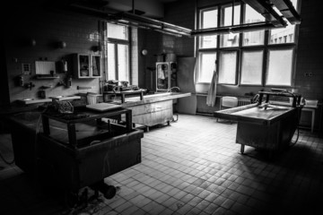 an autopsy room interior low light