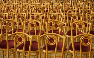 Empty rows of chairs in the concert hall