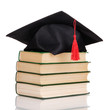 Grad hat with books isolated on white