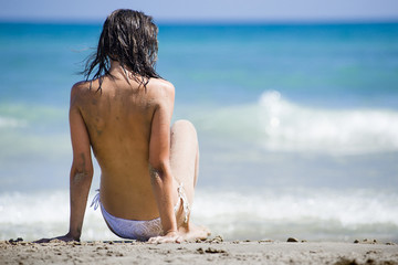 Topless woman at the beach