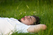 man relaxing on the grass