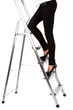 Woman climbing up ladder isolated on white