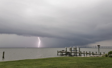 A bolt of lightening pierces the water in the Chesapeake Bay