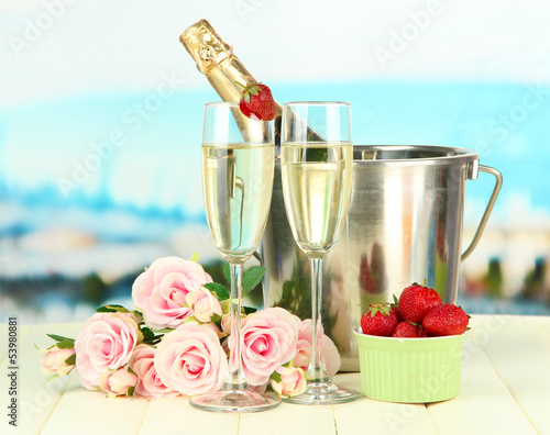 Romantic still life with champagne, strawberry and pink roses,