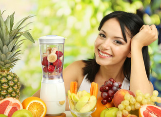 Girl with fresh fruits on natural background