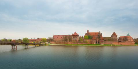Teutonic castle Malbork in Pomerania region of Poland over Nogat