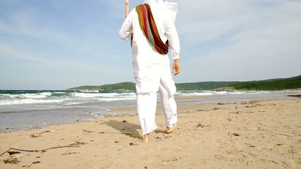Arab Man Walking on Beach HD