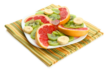 Assortment of sliced fruits on plate, isolated on white