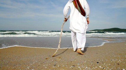 Middle Eastern Man with Staff Walking  Sea Religious Concept