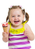 happy kid girl eating ice-cream in studio isolated