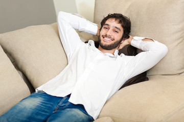 Young man relaxing on the sofa