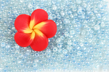 Blue beads with decorative handmade flower closeup