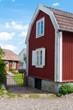 Rote Holzhäuser in Pataholm, Schweden