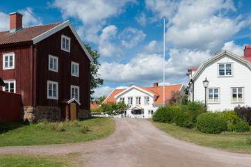Typische Holzarchitektur im Küstenort Pataholm, Småland