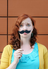 Girl with mustache party accessory