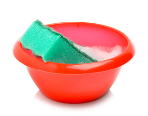 Red bowl and green sponge with foam