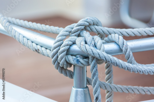 Mooring rope tied around steel anchor