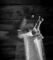 sand running through hand