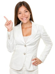 Businesswoman With Hand On Hip Pointing Sideways