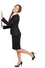 Businesswoman Standing On One Leg With Hands On Wall