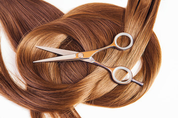 hairdresser scissors on the hair