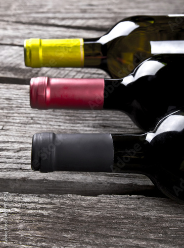 Wine bottle on a wooden table Canvas