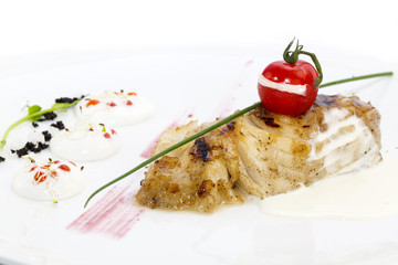 Roasted fillet of grilled fish in a white sauce