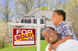 Mixed Race Father and Son In Front of Real Estate Sign and House