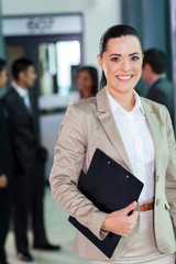 attractive young corporate worker in office