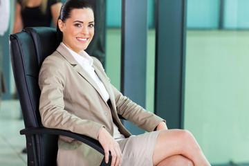 cute female corporate worker sitting in boardroom