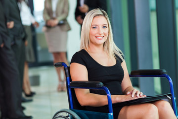 disabled businesswoman sitting in a wheelchair