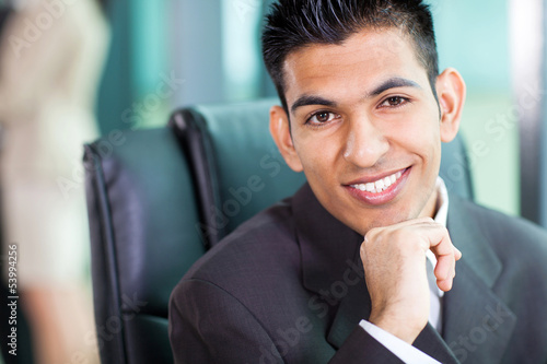 headshot of young Arabian businessman