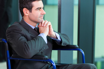 handicapped businessman sitting in a wheelchair
