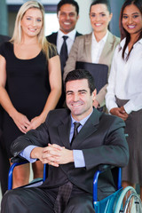 businessman in wheelchair with colleagues