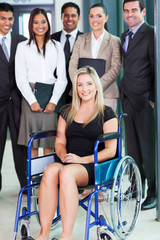 disabled young businesswoman and team